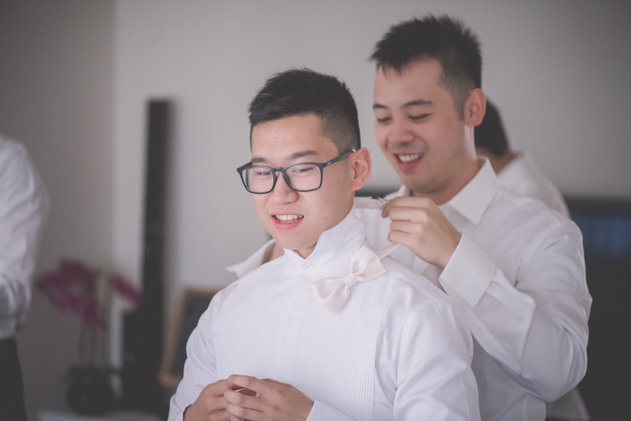 The best man help the groom on his wedding day