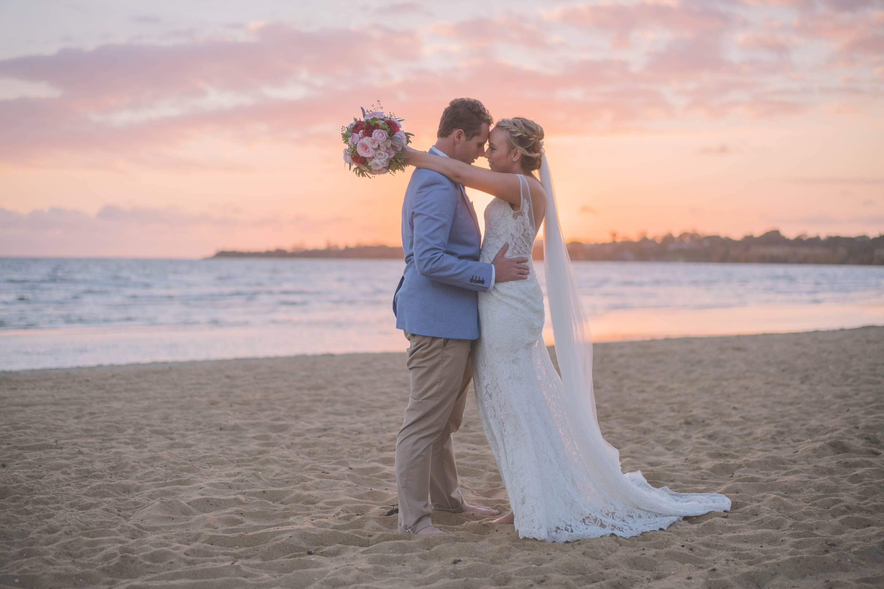 Wedding photography in Melbourne of a couple on a beach at sunset