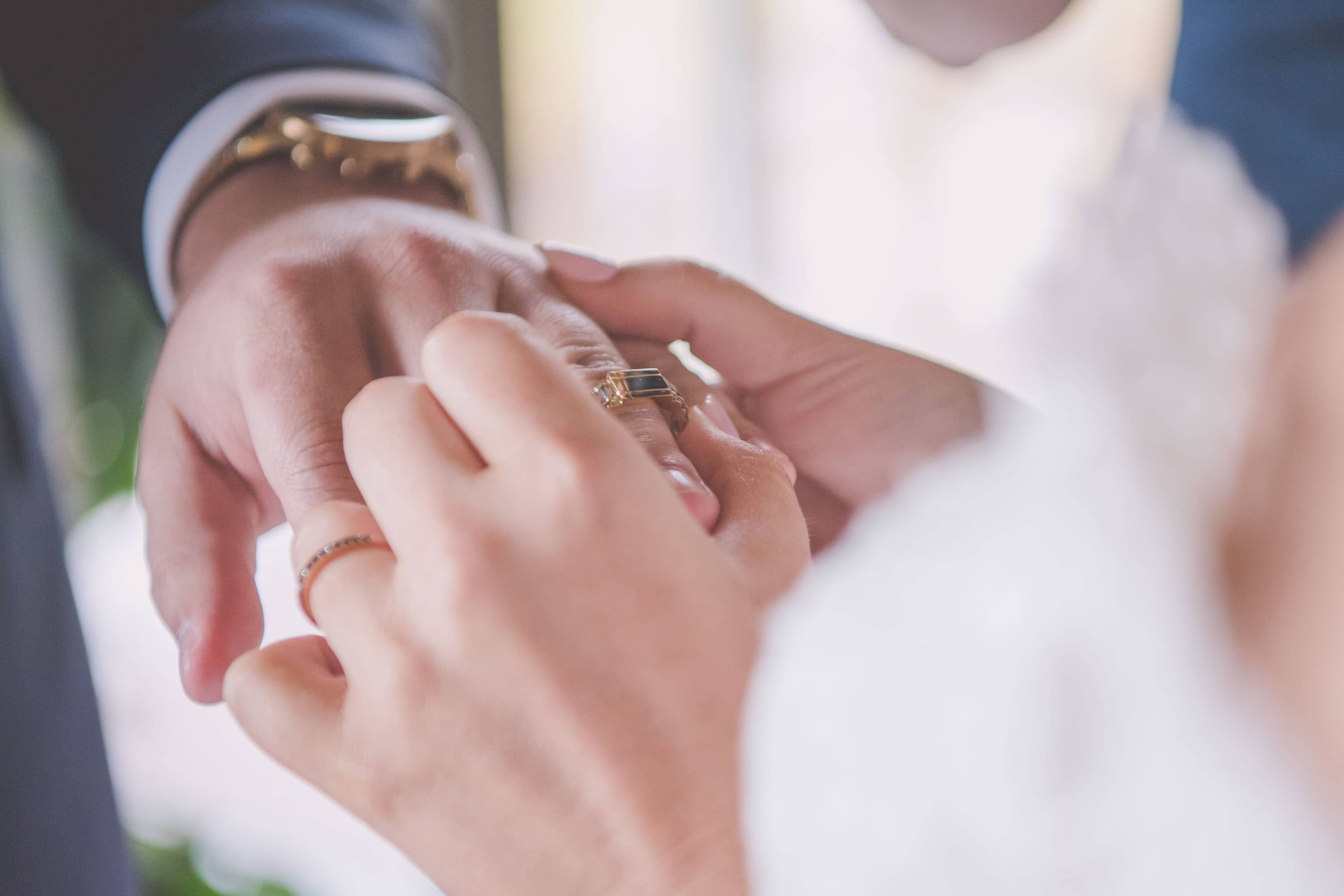 Alicia puts a gold ring on Lachlan's finger at their wedding
