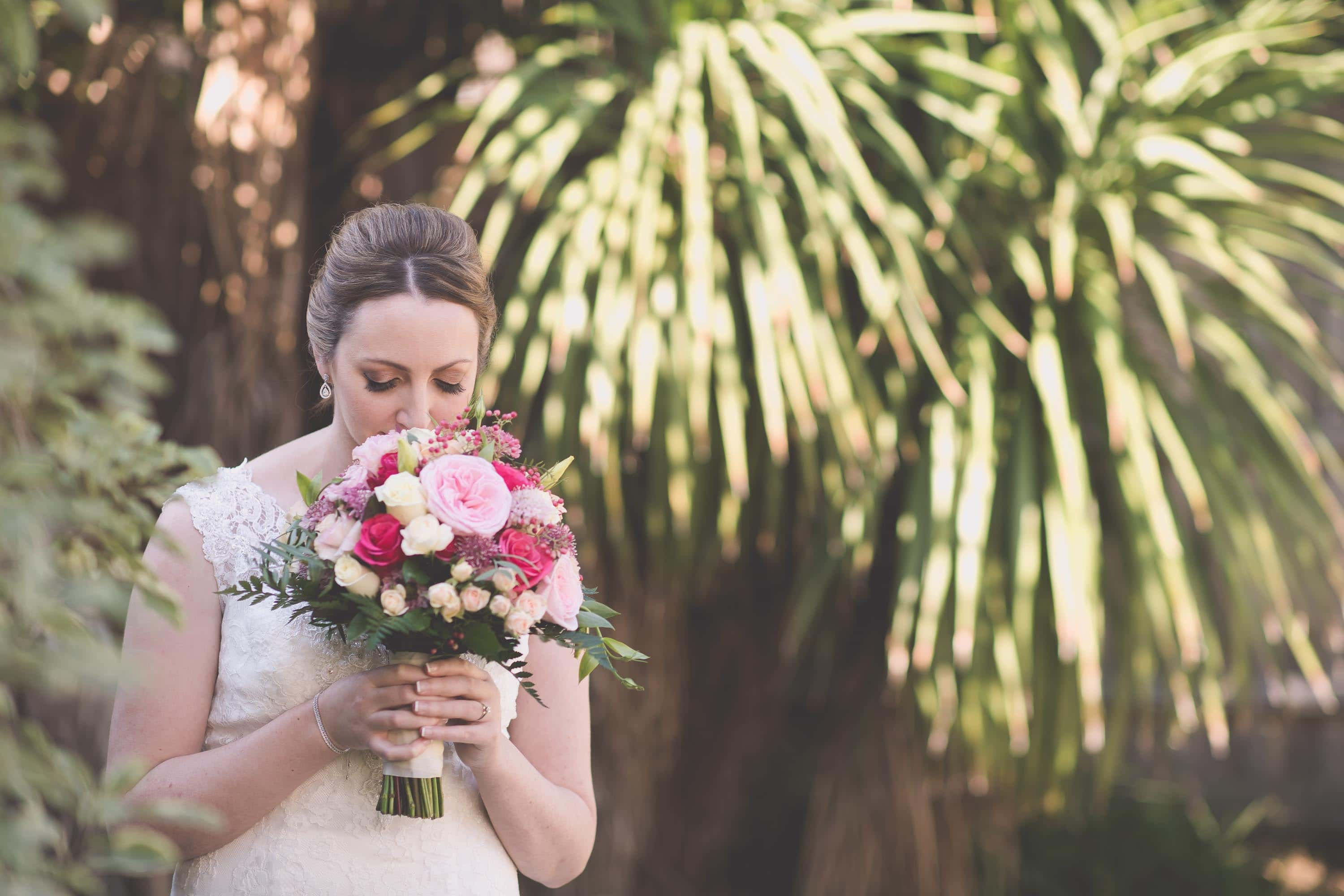 A bride smells her bouquet