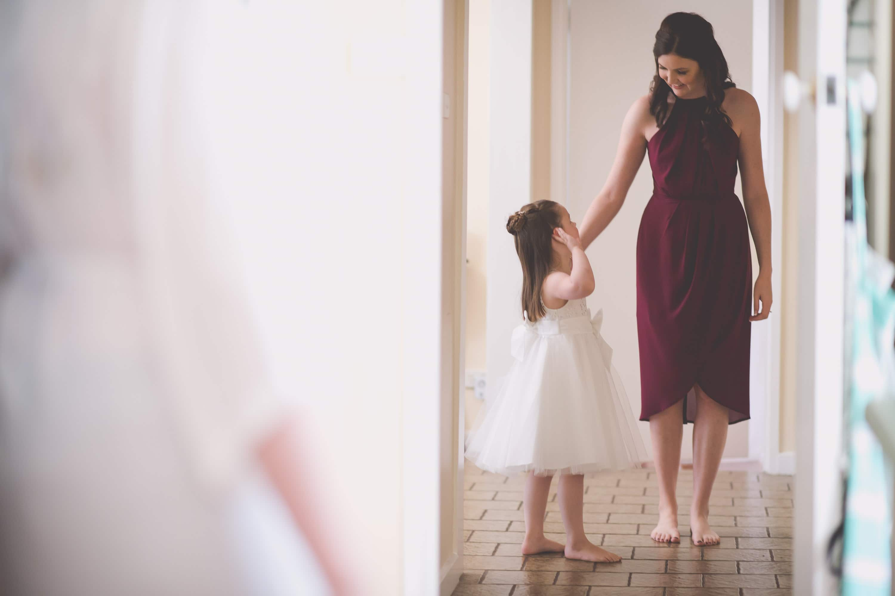A bridesmaid and her daughter