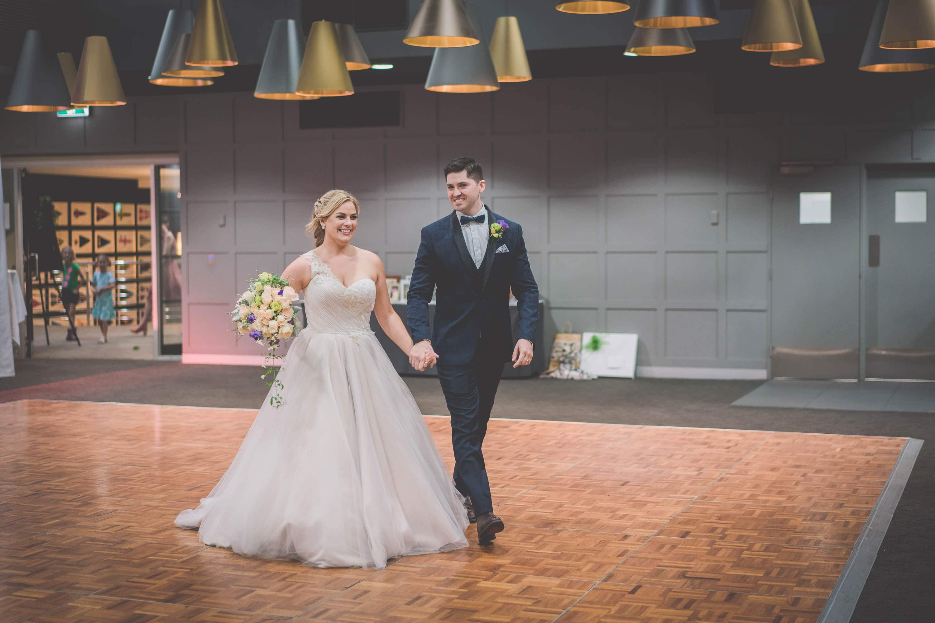 The bride and groom make their grand entrance to their wedding reception in Melbourne